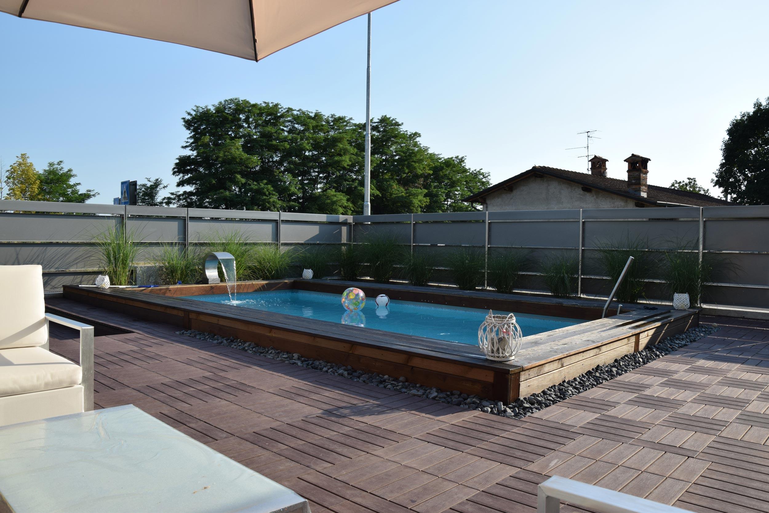 Giardino con piscina rialzata progettazione giardini - Piscina bagnolo mella ...